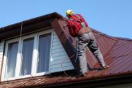 Master Painter from Peintre Victoriaville who repaints a roof.